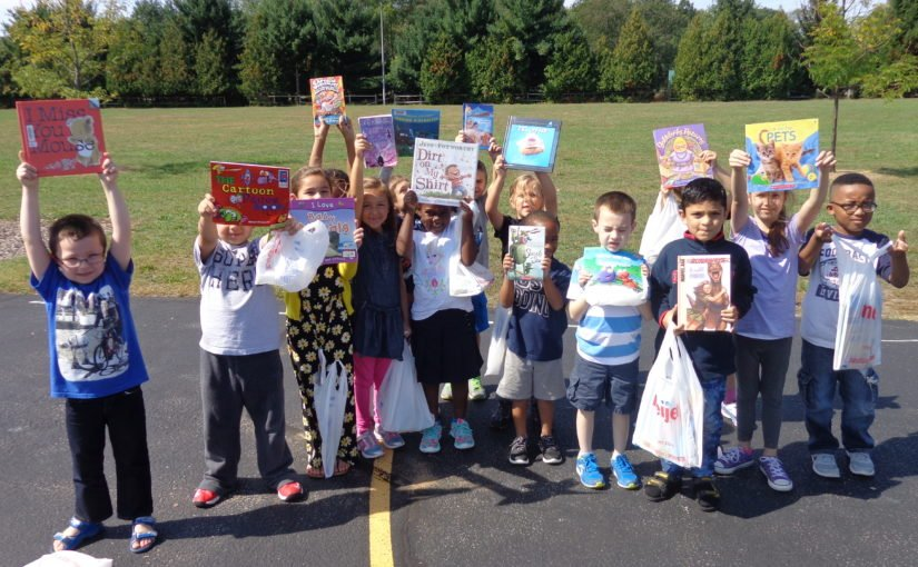 Students at Walt Disney Elementary show off the books they picked out.